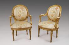 Pair of carved gilt armchairs