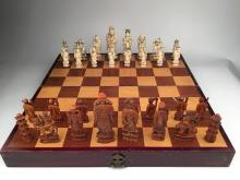 Thirty two piece carved ivory chess set with seperated lined dividers.<BR>Largest