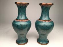 A pair of Japanese baluster shaped cloisonne vases.