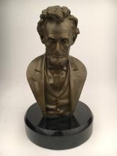 Abraham Lincoln modern recast bronze bust mounted on a round marble base.