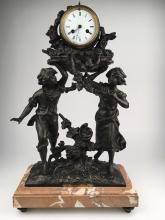 White metal decorative clock with plate reading