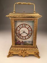 French gold gilt repeater clock with painted porcelain panels.<BR>Overall height 7
