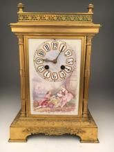 A French mantle clock with a painted porcelain
