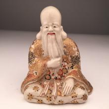Japanese Satsuma porcelain figure of one of the Seven Lucky Gods.<BR>7 1/4 inches.