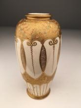 A nice Japanese Satsuma vase.<BR>Artist signed on the bottom<BR>Height 5 1/8 inches.