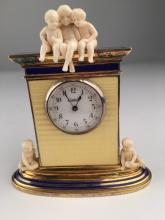 Cartier figural desk clock with three young children on the very top and another