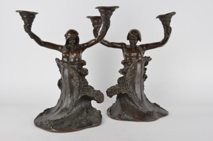 A pair of Art Nouveau bronze candalebras.Attributed to Charles Louchet, French