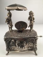 925 Silver mechanical singing bird box with two young children standing,