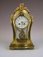 French mantle clock in a gold case with unique  beveled glass sides and top.