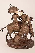 Bronze and ivory figurine of a lady with a parasol and a men reaching across