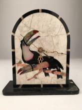 Pietra dura clock with a tucan on the front.<BR>One C battery required.<BR>Height 8