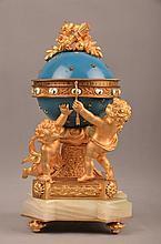 Blue enamelled and gold gilt bronze annular clock.