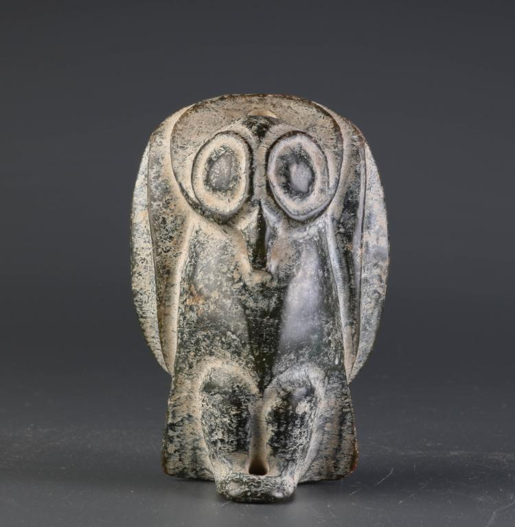 African stone carving of a boy mythical bird