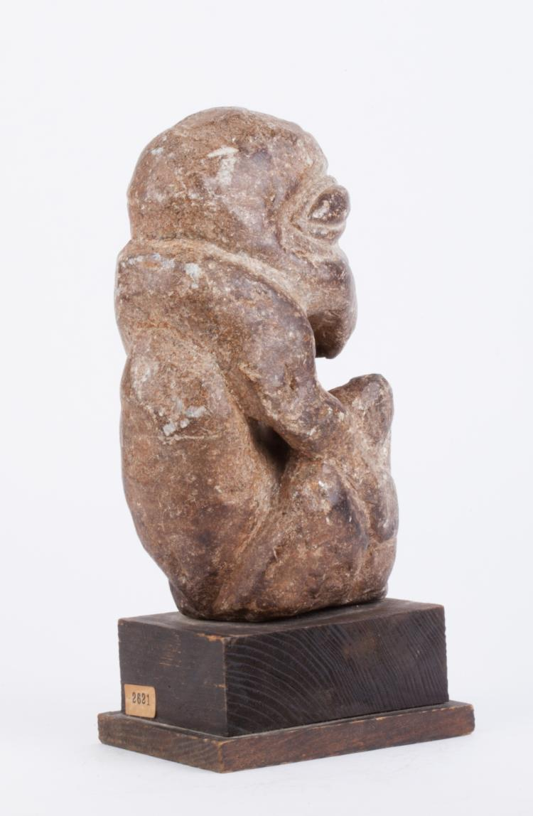 African stone carved man statue