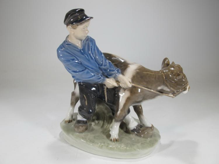 Royal Copenhagen Boy & calf porcelain figure