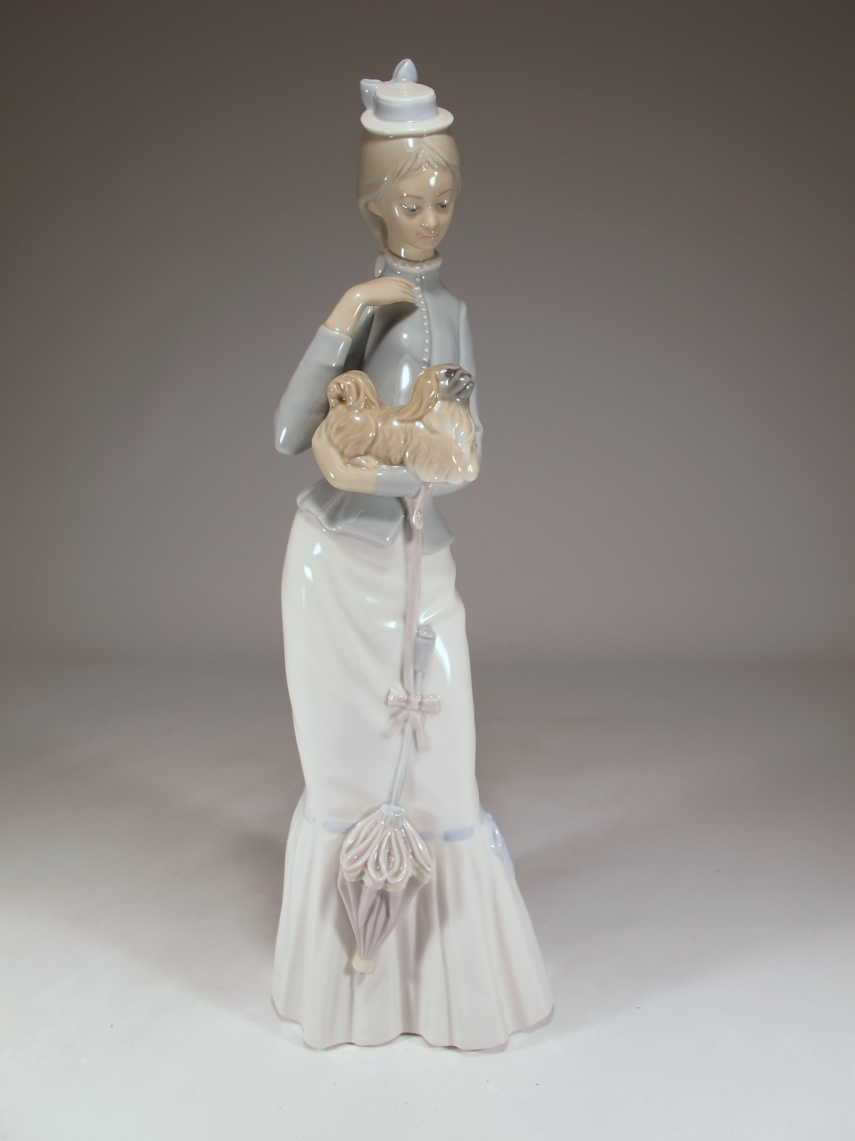 Lladro Walk with the Dog porcelain statue
