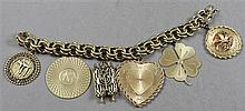 STAMPED 14K YELLOW GOLD CHARM BRACELET WITH 6 CHARMS, 8