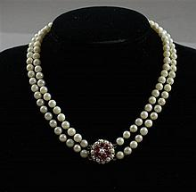 DOUBLE STRAND CULTURED PEARL NECKLACE WITH RUBY AND PEARL ACCENTED STAMPED 14K YELLOW GOLD CLASP, 16