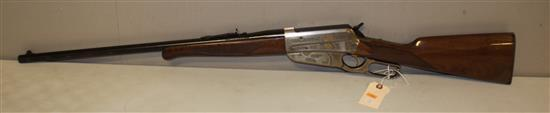 WINCHESTER MODEL 1895 .405 CALIBER LEVER RIFLE SN: NFH0877, HIGH GRADE, WATER DAMAGE TO HEAL OF BUTT STOCK, INCLUDING NON-MATCHING H...