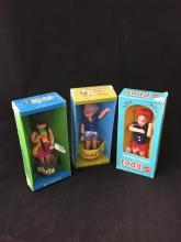CHRIS AND (2) TODD DOLLS IN ORIGINAL PACKAGING.