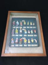 ORIGINAL HERTWIG & CO. ALL BISQUE DOLL SALESMAN SAMPLE BOARD IN SHADOW BOX. 21 TINY CHARACTER FIGURES,  MOST 2