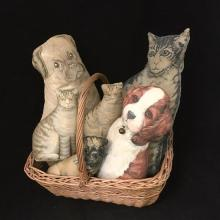 BASKET FILLED WITH (6) PRINTED CUT-OUT CLOTH ANIMALS INCLUDING CATS AND DOGS.