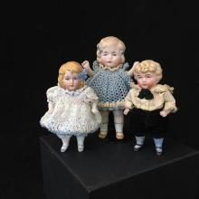 (3) GERMAN ALL BISQUE DOLLS.  STIFF NECKS, MOLDED AND PAINTED HAIR AND FACIAL FEATURES, WIRE JOINTED ARMS AND LEGS, PAINTED SHOES, 4...