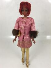 CHRISTIE TWIST & TURN WITH RED HAIR WEARING PINK LAME'' JACKET FROM