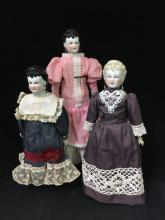 (3) CHINA HEAD LADIES WITH PIERCED-IN EARS.  BELIEVED TO BE MADE IN JAPAN, ALL APPEAR TO BE FROM THE SAME MOLD.  MOLDED AND PAINTED...