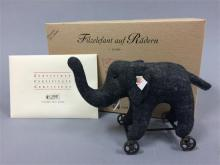 STEIFF FELT ELEPHANT ON WHEELS, 12cm STEIFF CLUB EDITION 2004 WITH ORIGINAL BOX.  MISSING RED CLOTH SADDLE,  THIS ITEM COMES FROM A...
