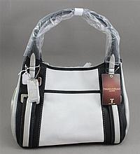 TIGNANELLO BLACK, WHITE, AND SILVER LEATHER PURSE WITH ORIGINAL TAG