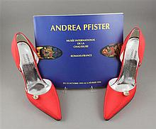 ANDREA PFISTER FOR CHARLES JOURDAN ITALIAN RED PUMPS AND AUTOGRAPHED MUSEUM EXHIBITION CATALOG