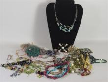 BOX LOT JEWELRY INCLUDING TWO PUKA NECKLACES AND ASSORTED BEADED COSTUME JEWELRY WITH CUFFS AND NECKLACES.