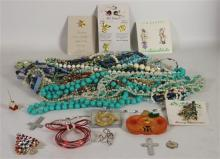 BOX LOT COSTUME JEWELRY: ASSORTED BEADED NECKLACES IN VARIOUS COLORS AND LENGTHS, HOLIDAY PINS WITH TREE MOTIF, AND A GOLD TONE SCAR...