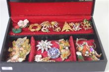 BLACK JEWELRY BOX WITH COSTUME PINS AND JEWELRY, MOSTLY CHRISTMAS