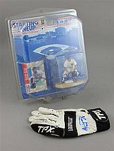 SIGNED PACKAGING WITH DEREK JETER ACTION FIGURE AND GLOVE