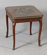 1920'S MAHOGANY FRENCH STYLE OCCASIONAL TABLE WITH BRASS AND ORMOLU TRIM AND RAISED MEDALLION PLAQUE