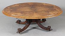 1920'S INLAID BURL MAHOGANY OVAL COFFEE TABLE WITH CARVED BASE