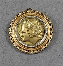 STAMPED 750, 18K TWO-TONE GOLD PIN/PENDANT WITH BLINDFOLDED WOMAN MOTIF, 1 3/4