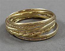 SIX BANGLE BRACELETS, VARIOUS STYLES INCLUDING HINGED MOST STAMPED 14K YELLOW GOLD, 2 1/2