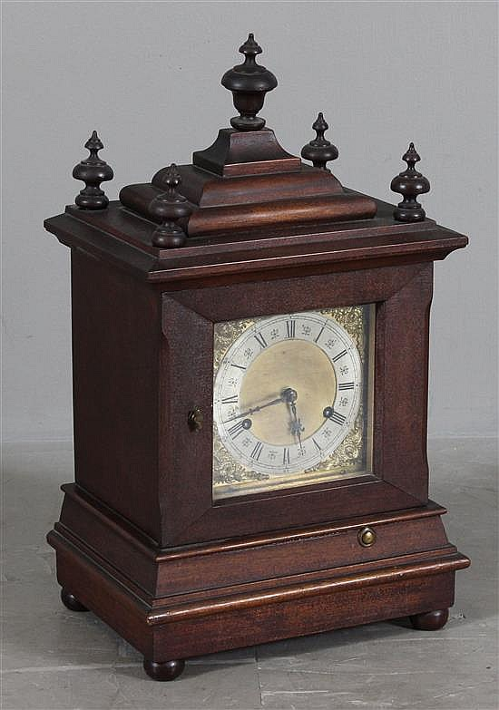 WALNUT MANTLE CLOCK WITH BRASS DIAL AND WOOD FINIALS, WITH