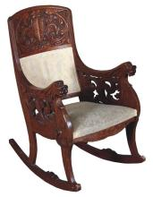 CARVED OAK ROCKER WITH FIGURAL ARMS, DRAGON AND CREST ON BACK - Wear to front of rocker, 40