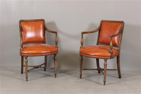 PAIR BAKER FURNITURE ARM CHAIRS WITH ORANGE LEATHER UPHOLSTERY - Slightly worn finish, 34