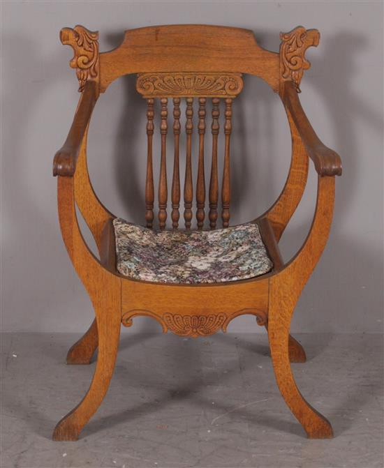 OAK VICTORIAN SPINDLE BACK ARM CHAIR WITH PRESSED CARVING AND LION HEAD DECOR, 34