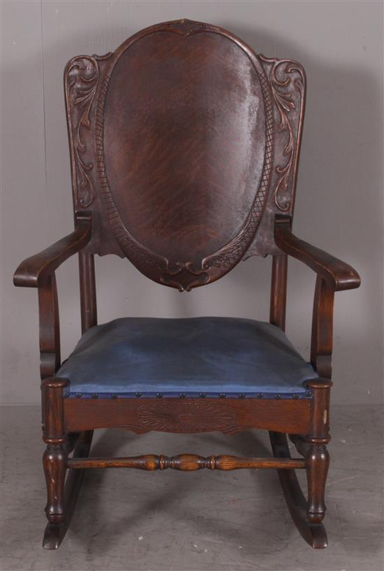 OAK VICTORIAN OPEN ARM ROCKER WITH APPLIED CARVING AND BLUE VINYL SEAT, 39