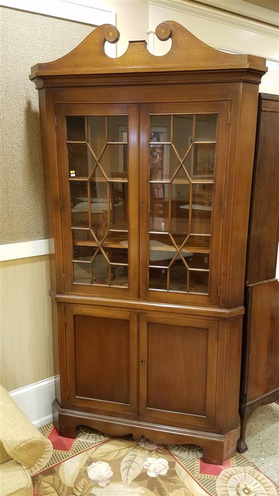 MAHOGANY ONE-PIECE CORNER CUPBOARD WITH INLAY AND BROKEN ARCH TOP, 45