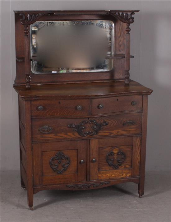TURN OF THE CENTURY OAK SIDEBOARD WITH HIGH MIRRORED BACK, CANDLE SHELVES, AND APPLIED CARVING, 43