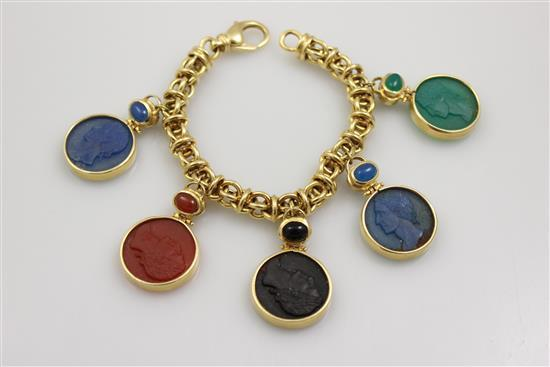 STAMPED 18K YELLOW GOLD ITALIAN FANCY LINK BRACELET WITH INTAGLIO SYTLE CHARMS, 8