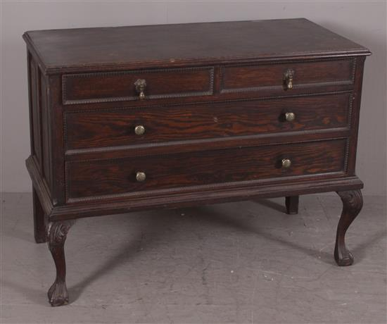 TURN OF THE CENTURY OAK 4-DRAWER LOW BOY WITH BALL AND CLAW FEET AND RAISED PANEL ENDS, 42