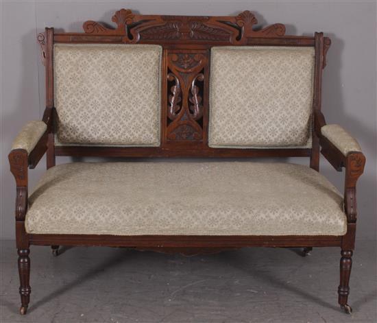 WALNUT EASTLAKE VICTORIAN LOVESEAT WITH UPHOLSTERED SEAT AND BACK, 50